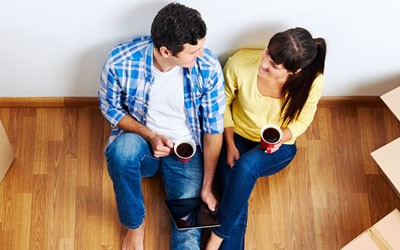 couple relaxing after booking cleaning appointment